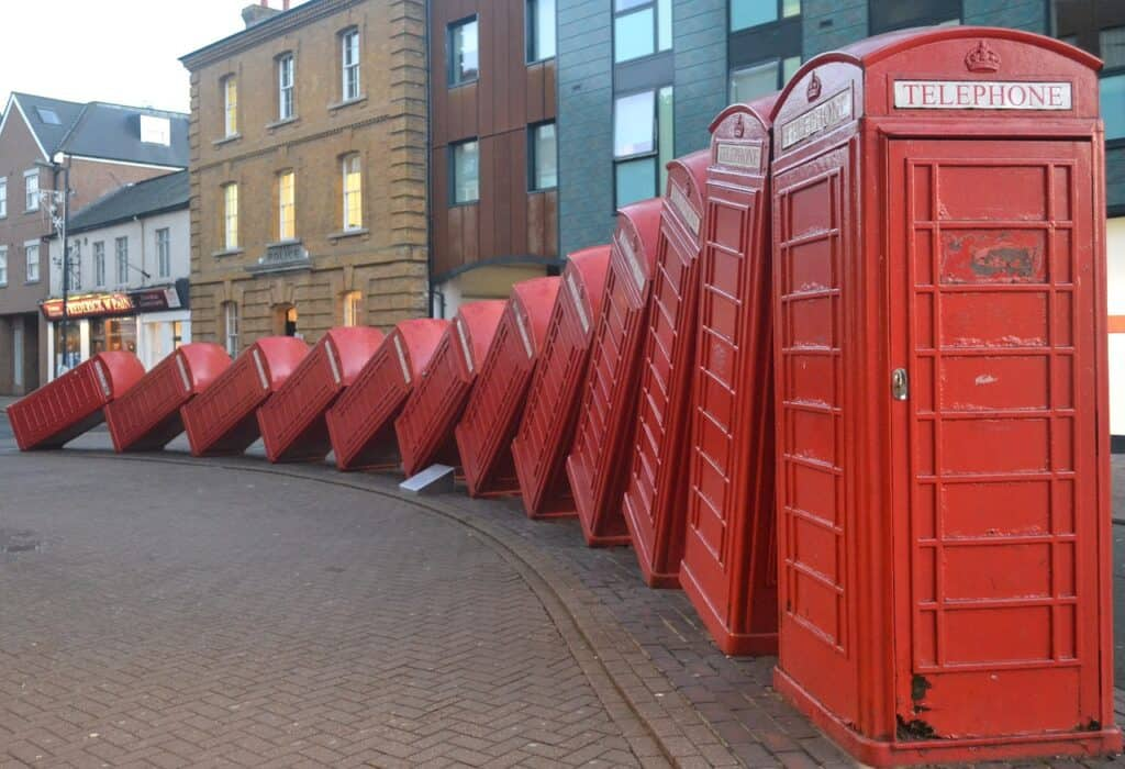 """A domino of phone boxes """"falling into place"""" for your call."""