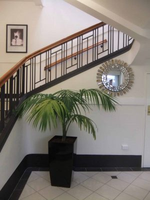 A grand staircase in an original Art Deco building from the 1930s enhanced with the right arrangement.
