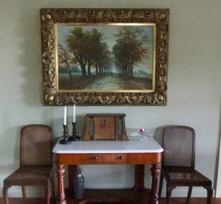 This picture frame looks impressive and massive, yet is brittle from age and easy to damage.