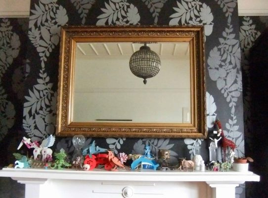 A large mirror on a dark wall can be a real highlight.
