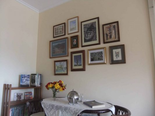 An otherwise bare wall radiates homeliness and warmth with a lovely picture montage idea.